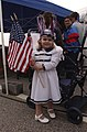 US Navy 030529-N-6639V-001 Operations Specialist 3rd Class Steven Peters' daughter waves her flags for her father.jpg