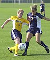 US Navy 030907-N-9693M-005 Navy midfielder Heather Thomas takes the ball from Drexel defender Kristen Andrews during a soccer game at the U.S. Naval Academy's Glenn Warner Soccer Facility.jpg