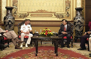 US Navy 031119-N-8590G-008 Cmdr. Richard Rogers, Commanding Officer of USS Vandegrift (FFG 48) meets with Vice Chairman of the People's Committee, Nguyen Thien Nhan.jpg