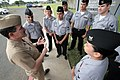 US Navy 050225-N-3228G-006 Master Chief Petty Officer of the Navy (MCPON) Terry Scott speaks to several Task Force Uniform volunteers at the Personnel Support Detachment on board Naval Station Pearl Harbor, Hawaii.jpg
