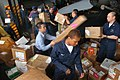 US Navy 050619-N-1332Y-041 Sailors unload and sort 6,837 pounds of mail.jpg