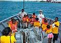 US Navy 050719-N-3342W-003 Children sponsored by Focus, HOPE, learn about Navy life aboard ship from U.S. Navy Lt. Jon Bush while aboard the U.S. Naval Sea Cadet training ship Grayfox (TWR 825).jpg