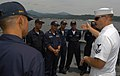 US Navy 050818-N-4104L-034 Fire Controlman 2nd Class Dean Crawford explains his visit, board, search and seizure (VBSS) security team leader role to Philippine Navy (PN) Sailors during VBSS training aboard the guided missile fr.jpg