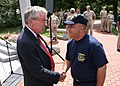 US Navy 060831-N-5367L-001 Medal of Honor recipient and Massachusetts Commissioner of Veteran's affairs, retired Navy Capt. Tom Kelley, greets chief petty officer selectees.jpg