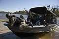 US Navy 061023-N-5319A-051 Sailors assigned to Naval Small Craft Instruction and Technical Training School (NAVSCIATTS) train personnel from the Iraqi Riverine Police Force on special boat maneuvers and weapon handling.jpg