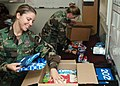 US Navy 061219-N-1522S-003 Master-at-Arms 3rd Class Leslie Orand and Master-at-Arms 2nd Class Denique Glenn, assigned to Naval Station Mayport Security Military Working Dog Unit, prepare holiday care packages for two of their d.jpg