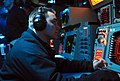 US Navy 070418-N-4124C-001 An operations watchstander, of Amphibious Squadron 11, analyzes ship movements of a synthetic battle group during a Fleet Synthetic Training exercise.jpg