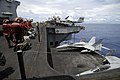 US Navy 070807-N-6326B-026 Sailors and Marines ensure the safe operation of elevator 2 while lowering two F-A-18A Hornets, assigned to the Red Devils of Marine Fighter Attack Squadron (VMFA) 232.jpg