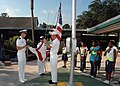 US Navy 070824-N-2491R-007 Lt. j.g. Calvin Staley, Aviation Electronics Technician 2nd Class Nathen Whisler, and Yeoman 2nd Class Soraida Ivanes participate in a flag raising ceremony for the students at Hyde Grove Elementary S.jpg