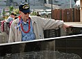 US Navy 071207-N-3283M-039 Pearl Harbor survivor and former crew member of USS Oklahoma (BB 37), Paul Goodyear reads the name of former shipmates lost on Oklahoma during a joint Oklahoma Memorial Committee-National Park Service.jpg