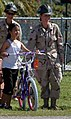 US Navy 071218-N-7367K-009 Builder 3rd Class Taylor Crow, a Seabee attached to Naval Mobile Construction Battalion (NMCB) 1, Guam Det., poses for a photo with a student at Chief Brodie Memorial Elementary School.jpg