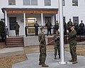 US Navy 080111-M-7906B-002 Cpl. Joseph Longo, Sgt. Bernadine Toledo, and Cpl. Scott Waligora, assigned to Marine Wing Headquarters, Squadron 2, prepare to raise the American flag.jpg
