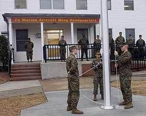 2nd Marine Aircraft Wing - Marines from 2nd MAW headquarters prepare morning colors for the first time at the new headquarters building in 2008.