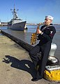 US Navy 080201-N-0857S-002 Musician 3rd Class Jay Gillespie, assigned to the Navy Band New Orleans, plays his saxophone as the Perry-class guided-missile frigate USS Samuel B. Roberts (FFG 58) docks at the Governor Nichols Whar.jpg