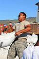 US Navy 080915-N-7955L-032 Staff Sgt. Julio Arriola, embarked aboard the amphibious assault ship USS Kearsarge (LHD 3), helps move supplies during a humanitarian assistance mission in Haiti.jpg