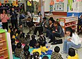 US Navy 081128-N-3262C-060 The amphibious command ship USS Blue Ridge (LCC 19) chief petty officers read to students from the Hong Kong Society for the Protection of Children during a community relations project.jpg
