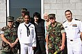 US Navy 090519-N-9013W-004 Joan Jett, lead singer of Joan Jett and the Black Hearts, poses with Sailors during Fleet Week New York City 2009 before boarding a Navy helicopter en route to the amphibious assault ship USS Iwo Jima.jpg