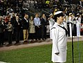 US Navy 090911-N-0413R-216 Musician 3rd Class Laura Carey sings the national anthem during a pre-game ceremony at Yankee Stadium.jpg