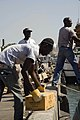 US Navy 100118-N-1134L-141 Members of the Jamaican Defense Forces Coast Guard unload supplies in Port-au-Prince.jpg