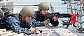 US Navy 100322-N-3666S-049 Boatswain's Mate Seaman Dastin Hernandez, left, and Fire Controlman 2nd Class Adam Conn stand guard with an M-60 machine gun.jpg