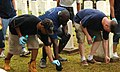 US Navy 100521-N-0464S-019 Sailors assigned to USS Paul Hamilton (DDG 60) pick up debris during a cleanup event at the Navy Veteran's Cemetery in Honolulu.jpg