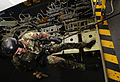 US Navy 100617-N-7317W-015 Explosive Ordnance Disposal Technician 3rd Class Peter Johal practices repelling in the hangar bay of the aircraft carrier USS Harry S. Truman (CVN 75).jpg