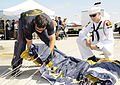 US Navy 101002-N-5366K-167 Special Warfare Operator 1st Class (SEAL) Aaron Darakjy shows a sea cadet how to pack his parachute after performing dur.jpg