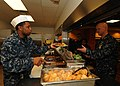 US Navy 110128-N-1092P-111 Culinary Specialist 3rd Class Justin Allen serves Naval Station Norfolk Command Master Chief David B. Carter at the base.jpg