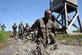 US Navy 110325-N-SI773-905 Sailors participate in a four-pit run obstacle during the 2nd annual Vietnam-6 Memorial Super Squad competition.jpg