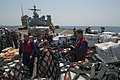US Navy 110409-N-RC734-287 Sailors and Marines remove cargo nets from pallets of supplies aboard the amphibious dock landing ship USS Comstock (LSD.jpg