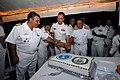 US Navy 110429-N-ZI300-113 UNITAS 52 Atlantic Phase Task Group commanders cut a ceremonial cake at the U.S. reception aboard USS Nitze (DDG 94).jpg
