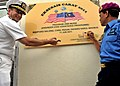 US Navy 110611-N-NJ145-125 Capt. John W. Gilman and Royal Malaysian Navy Rear Adm. Nasaruddin bin Othman ign the dedication plaque during the turno.jpg