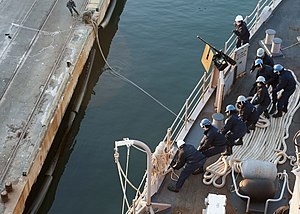 US Navy 111219-N-NR955-058 Sailors heave a mooring line during sea and anchor detail docking as the Whidbey Island-class amphibious dock landing sh.jpg