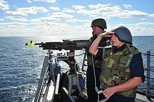 US Navy 120131-N-OP638-021 Gunner's Mate Seaman Shaina M. Hammack, front, and Gunner's Mate Seaman Lauren A. MacNeil man an M240 machine gun while.jpg