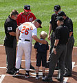 Umpires and Buck Showalter.jpg