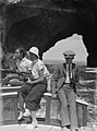 View of two women and a man seated on a boat (AM 87726-1).jpg