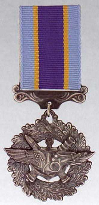 Medal For Military Service to Ukraine - Image: Vijs slug