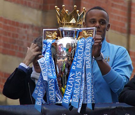 Kompany with the Premier League trophy after the victorious 2011-12 season Vincent Kompany holds up the Premier League trophy 2012.jpg