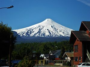 Pucón - Villarrica volcano as seen from a main Pucón street