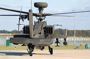 AgustaWestland Apache - Rear view of an Apache preparing to takeoff, the narrow body is apparent