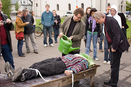 Demonstration of waterboarding at a street protest during a visit by Condoleezza Rice to Iceland, May 2008 Waterboarding.jpg