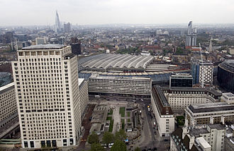 Lambeth Marsh - The disused Grimshaw-designed shed of the former Waterloo International can be seen nearer to camera, with the older train shed behind. In the foreground are the Shell Centre (left) and County Hall (right).