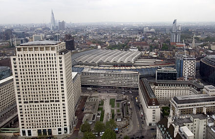 The disused Grimshaw-designed shed of the former Waterloo International can be seen nearer to the camera, with the older train shed behind. In the foreground are the Shell Centre (left) and County Hall (right). Waterloo station and vicinity.jpg