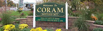 Coram, New York - Welcome sign at the east corner of NY 25 and 112.