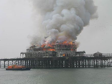 Fire on West Pier in Brighton, England West Pier fire with boat 20030328.jpg