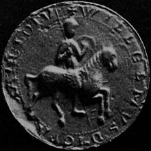 Black and white photograph of a mediaeval seal depicting a mounted knight.