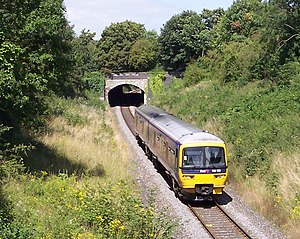 Oxford–Bicester line - A Class 165 DMU leaves Wolvercote Tunnel, heading towards Oxford.