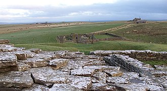 Wyre, Orkney - Wyre, viewed from Cubbie Roo's Castle, with the ruined chapel and burial ground visible.