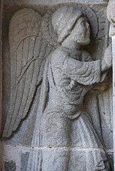 The angel of the Annunciation, at the west porch of the church of Saint-Georges