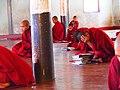 Young buddhist monks praying in Kalaw (Myanmar 2013) (11773359306).jpg